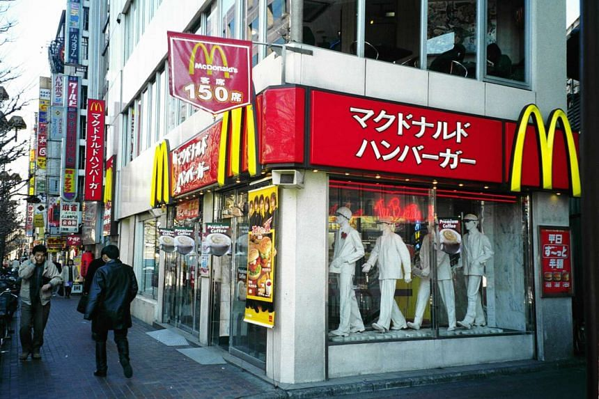 A woman in Japan injured her mouth after a green tea latte frappe she bought from McDonald's was found to have plastic shards inside.