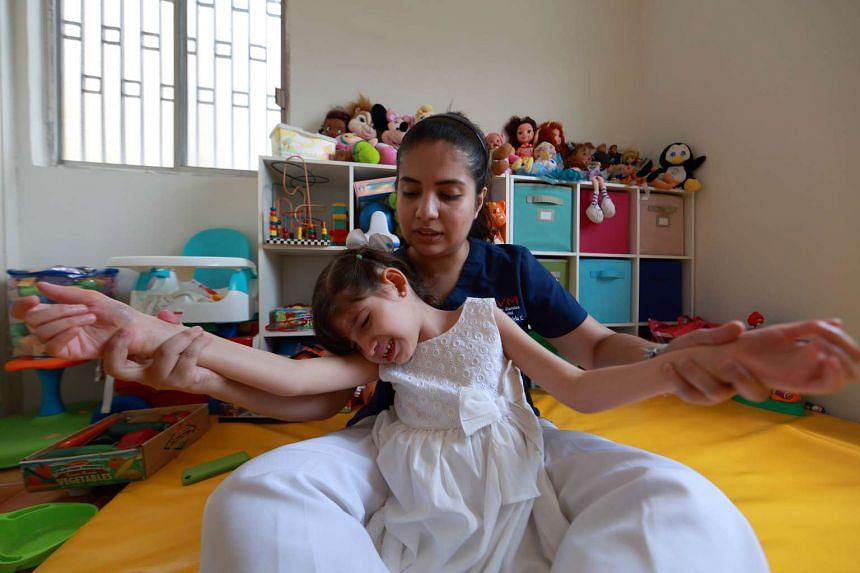 Graciela Elizalde and her physiotherapist, Ana Campos, at her home in the Guadalupe municipality near Monterrey on Sept 2, 2015.
