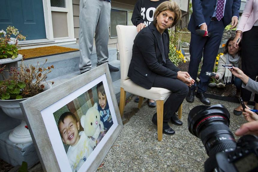 Tima Kurdi, sister of Syrian refugee Abdullah Kurdi whose sons Aylan and Galip and wife Rehan were among 12 people who drowned in Turkey trying to reach Greece, cries while speaking to the media outside her home in Coquitlam, British Columbia on Sept