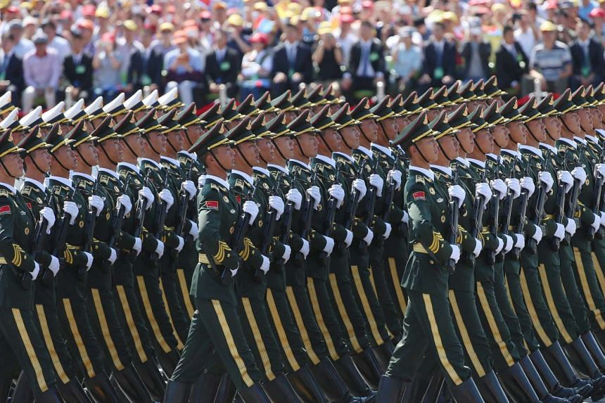 Chinese People's Liberation Army soldiers marching at the military display.