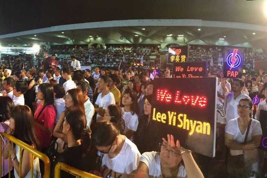 PAP supporters attending the rally for East Coast GRC at Bedok Stadium last night.