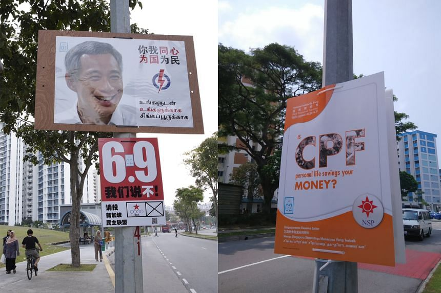 """Left: A Singapore Democratic Alliance's campaign poster, """"Say no to 6.9"""", refers to the top-end forecast of a Population White Paper that the Government put out in 2013. Right: A National Solidarity Party poster highlights one of its election issues."""