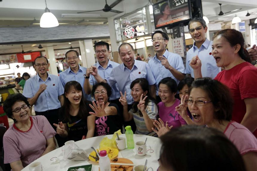 Above: (From left) WP's Mr Mohamed Fairoz Shariff, Mr Dennis Tan, Dr Daniel Goh, party chief Low Thia Khiang and Mr Gerald Giam at New Upper Changi Road food centre.