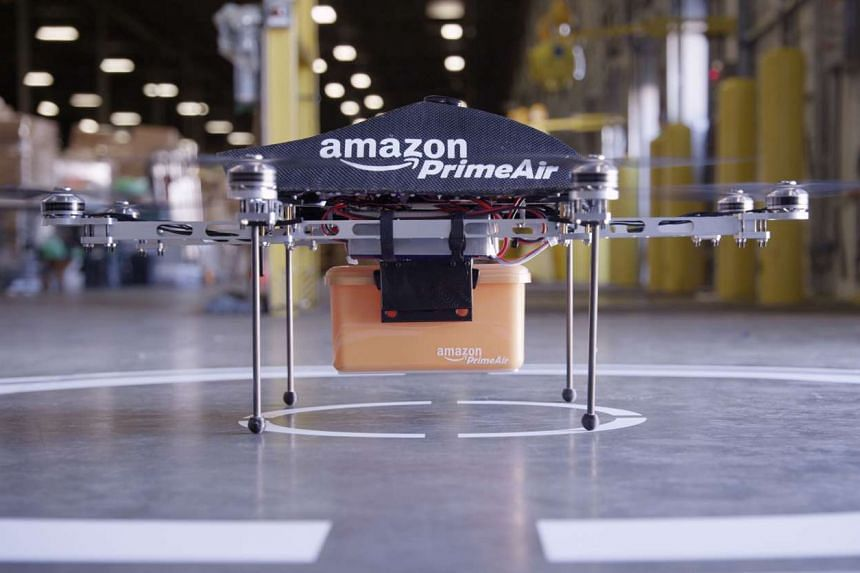 (Above) One of online retail giant Amazon's test drones for delivering goods. One of the ideas in the Infocomm Media 2025 masterplan is to have drones deliver small packages to shoppers.