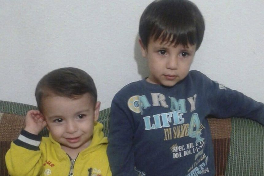 Aylan Kurdi (left) and his brother Galip pose in an undated photo provided by the Kurdi family.