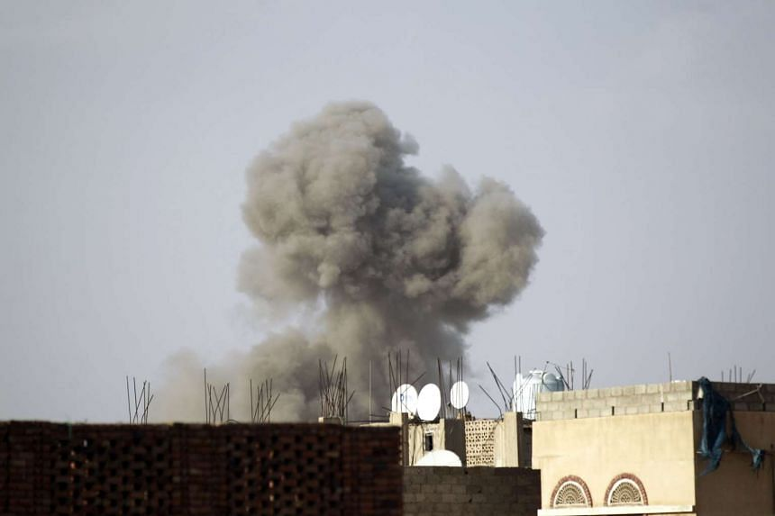 Smoke billows from the defence ministry in the Yemeni capital, Sanaa, during a Saudi-led coalition air strike on Sept 4, 2015.