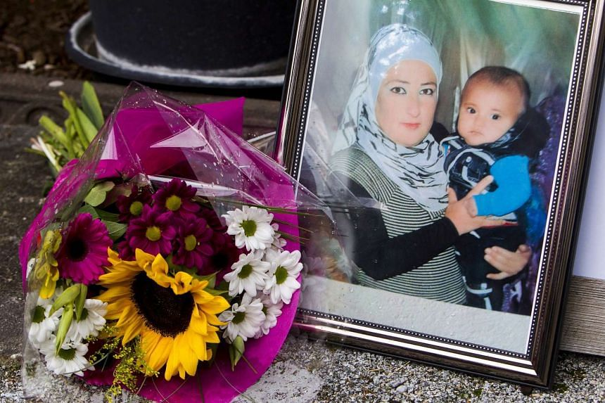A photograph of Syrian woman Rehan Kurdi holding her son Aylan is pictured next to a bouquet of flowers outside the home of Rehan's sister-in-law Tima Kurdi in Coquitlam, British Columbia on Sept 3, 2015.