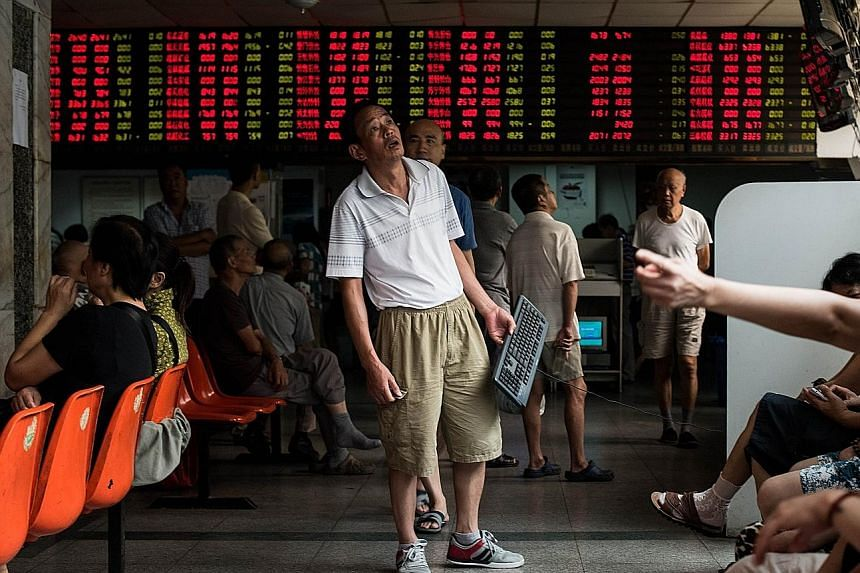 Investors at a Shanghai brokerage. The Chinese authorities are trying to shore up share prices after the benchmark Shanghai index plunged 30 per cent in the three weeks from mid-June.