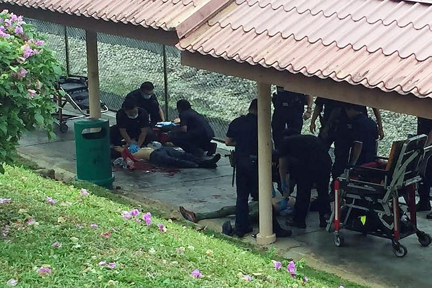 The suspect (above, lying on the ground), 39, was arrested for allegedly stabbing a 48-year-old man repeatedly at a covered walkway near Ang Mo Kio MRT station during yesterday's morning rush hour.