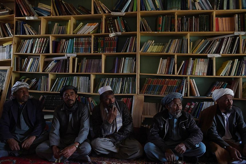 Afghan farmers in Bamiyan province meeting to consider forming a militia to guard the country's largest iron ore reserve buried in the ridges flanking their village.