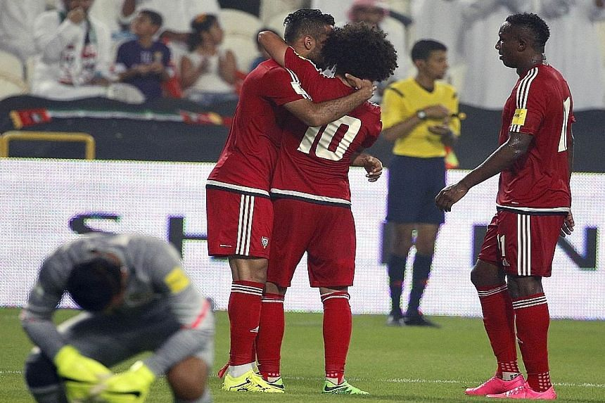 UAE players celebrate after scoring a goal against Malaysia during the 10-0 rout in the AFC qualifying match for the 2018 World Cup in Abu Dhabi on Thursday. The loss prompted Johor crown prince Tunku Ismail Sultan Ibrahim to say the state would cont