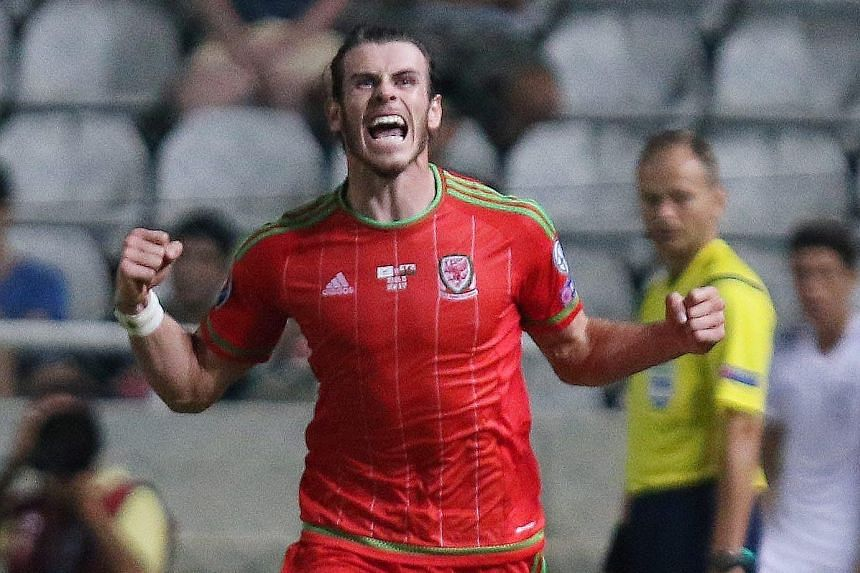 Wales football star Gareth Bale celebrating his winner against Cyprus, which sees his country just one win away from securing their place in next year's European Championships.