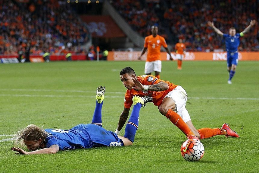 Netherlands defender Gregory van der Wiel (right) giving away a penalty for this foul on Iceland's Birkir Bjarnason, which drew stinging criticism from his coach.