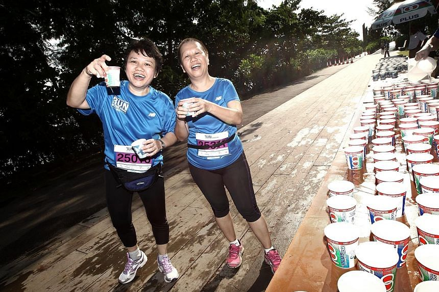 Stay hydrated at water points, like what participants did at the ST Run in the Park 2013. A good guide is to aim for 400-800ml an hour.