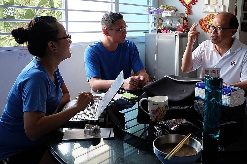 (Clockwise from far left) Mrs Serene Seah, 35, and Mr Seah Seng Siong, 37, discuss the issues they are facing with Mr David Ong during his visit to their home. The PAP's Mr Ong is up against SDP's Mr Sadasivam Veriyah and independent Samir Salim Neji
