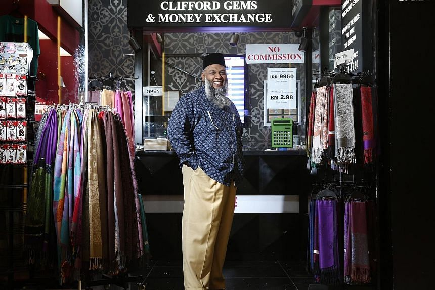 Recent currency fluctuations have made business more difficult. Usually, Mr Rafeeq has one price for the ringgit daily, but now he could have up to three ringgit prices in a day.