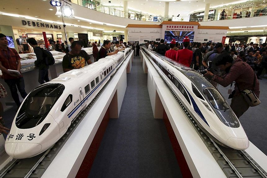 Models of high speed trains were displayed at the China High Speed Railway on Fast Track exhibition in Jakarta last month. China and Japan were both bidding for the high-speed rail project that was scrapped by Indonesia.