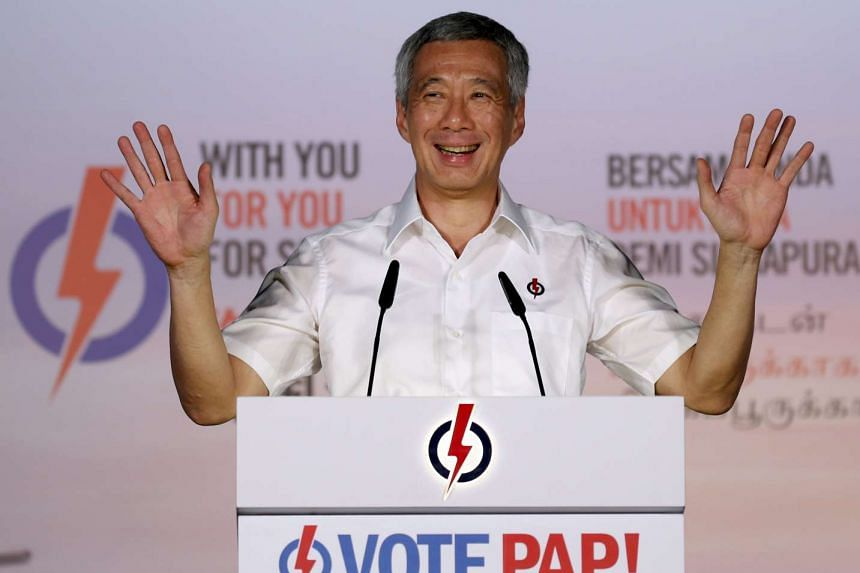 PM Lee Hsien Loong gestures as he speaks during a rally in Singapore on Sept 4, 2015.