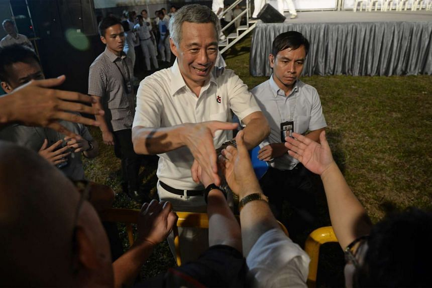 Prime Minister Lee Hsien Loong meeting supporters after the People's Action Party rally in Defu on Sept 4.