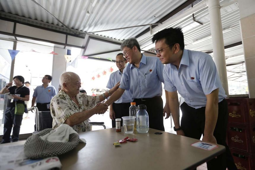 WP's Hougang SMC candidate Png Eng Huat (second from right) shaking hands with a resident at Changi Village on Sept 5, 2015.