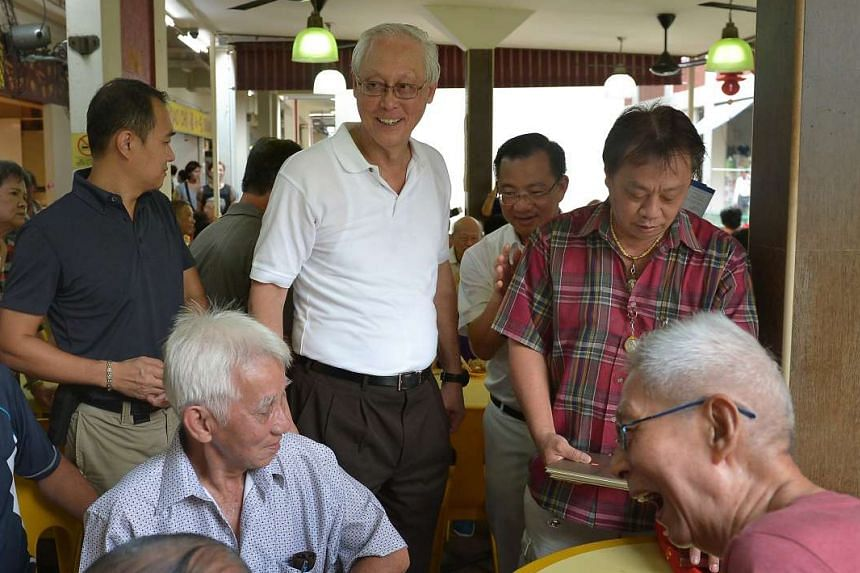 Emeritus Senior Minister Goh Chok Tong (centre) and Mr Seah Kian Peng, of the PAP's Marine Parade GRC team, in Serangoon Avenue 3 yesterday.