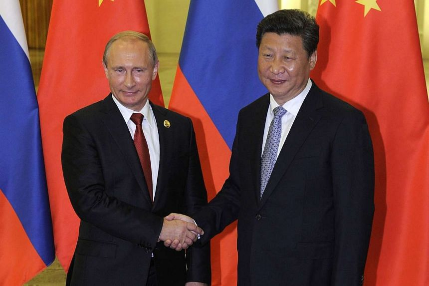 Mr Xi with Mr Putin on Thursday, after they attended a big military ceremony marking the 70th anniversary of Japan's defeat in World War II. They were expected to sign a contract for delivery of natural gas from Western Siberia, but that did not take