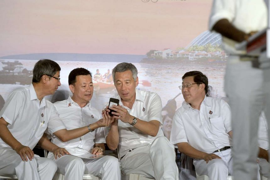 Among those on stage at the rally were (from left) former labour chief Lim Boon Heng, Aljunied GRC candidate Victor Lye, Prime Minister Lee Hsien Loong and Aljunied GRC team leader Yeo Guat Kwang. PM Lee detailed plans for new MRT stations, better am