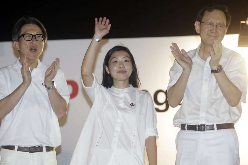 Ms Cheryl Chan, the PAP's candidate for the SMC, waving to the crowd after her speech. With her were East Coast GRC candidate Lim Swee Say (at left) and retiring MP Raymond Lim.