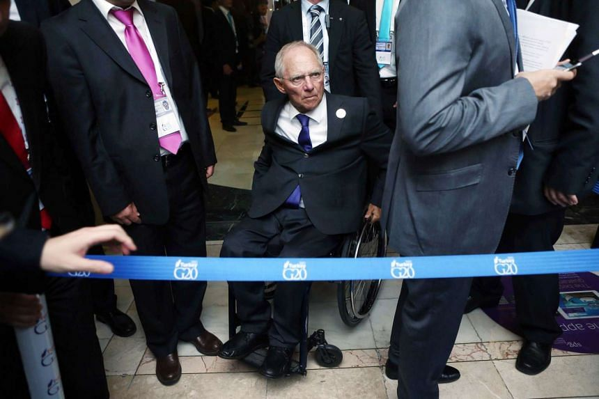 German Finance Minister Wolfgang Schaeuble arrives for a session during the G-20 Finance Ministers and Central Bank Governors meeting in Ankara on Sept 5, 2015.