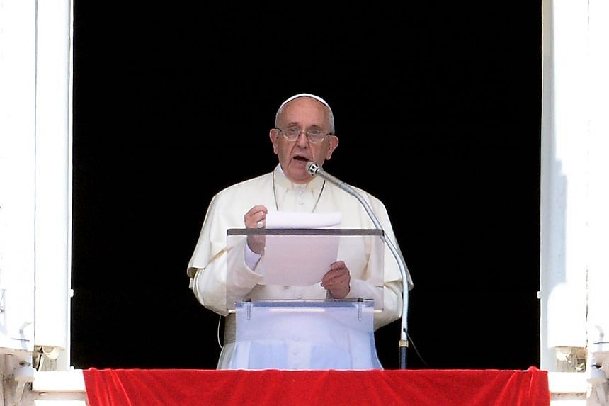 Pope Francis delivers his speach as he leads the Sunday Angelus prayer from the window of his study overlooking St. Peter's Square at the Vatican on Sept 6, 2015.