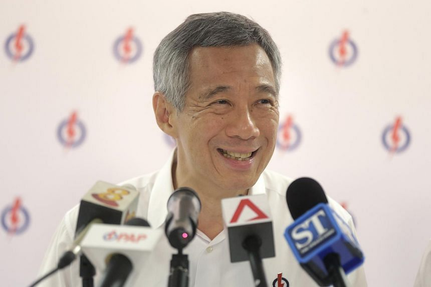 Prime Minister Lee Hsien Loong speaks during a press conference with the media at PAP's headquarters in Bedok on Sept 5, 2015.