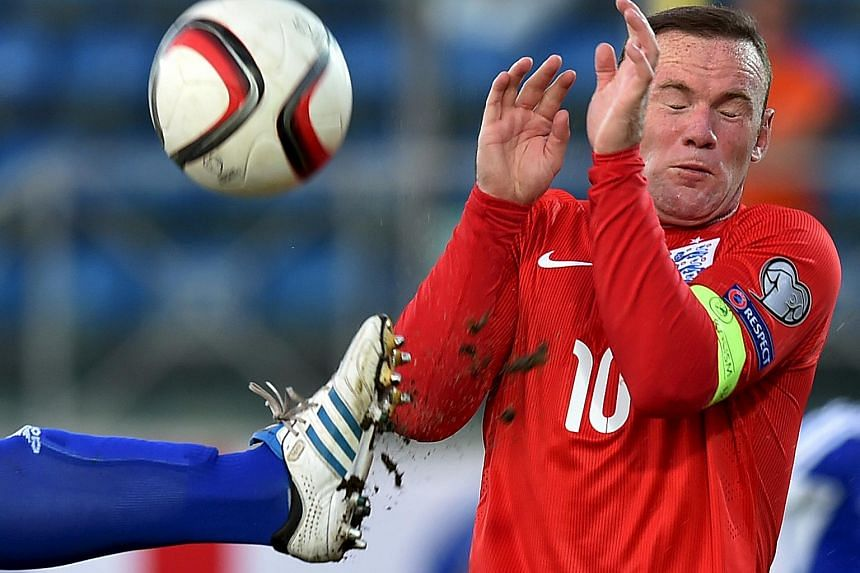 England's Wayne Rooney covers himself during their Euro 2016 qualifying soccer match against San Marino at the Olympic stadium in Serravalle, San Marino, Sept 5, 2015.