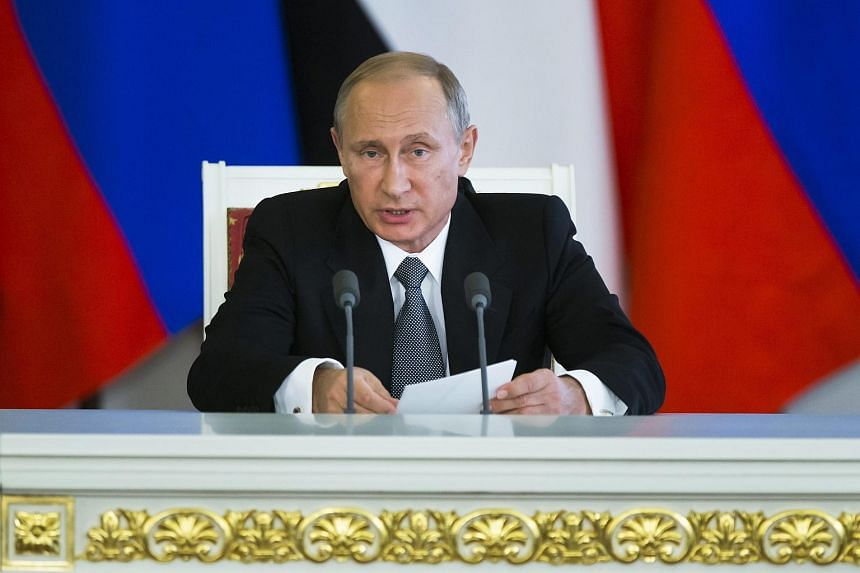 President Vladimir Putin at a talk in the Kremlin in Moscow, Russia on Aug 26, 2015.