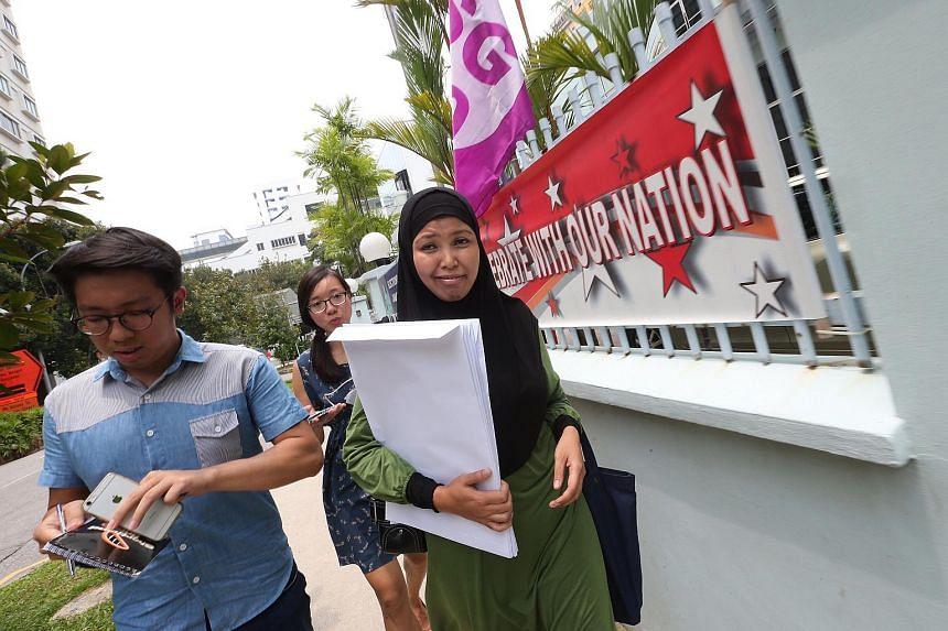 National Solidarity Party's assistant treasurer Nor Lella Mardiiiah Mohamed (right) at the Elections Department on Aug 26, 2015.