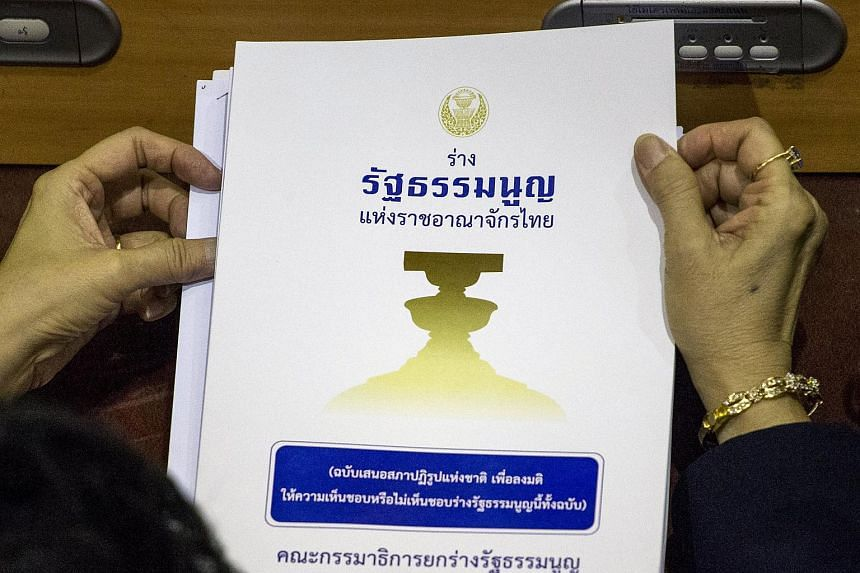 A draft of a new Thai constitution is pictured during a vote by members of the country's National Reform Council (NRC) at the parliament in Bangkok, Thailand, on Sept 6, 2015.