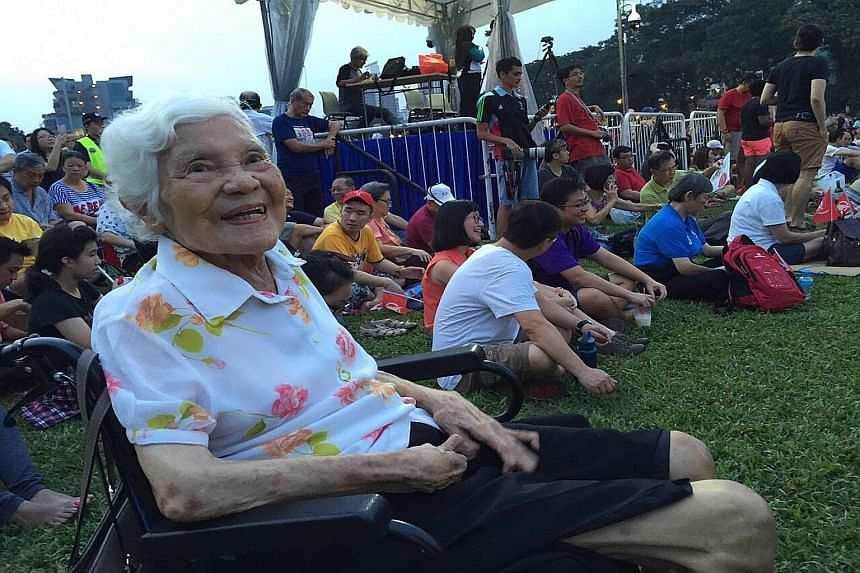 Left: Bus driver Ong Ah Guan, 53, with his collection of flags of opposition parties. He was at the SingFirst rally in Queenstown last night. Above left: Madam Sheila Ho, 88, asked her daughter to take her to the Singapore Democratic Party rally in C