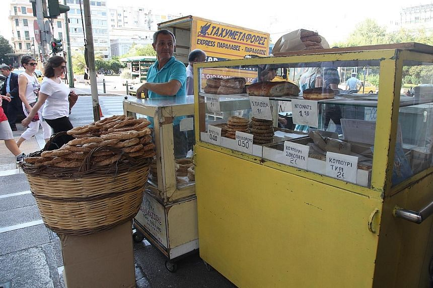 Sample food such as koulouri, a bread ring, from vendors (left) along the streets in Athens; and cured meats (below). Ancient sites in Greece include the Acropolis (left) in Athens and the Palamidi Fortress (above) at port town Nafplio. The sea view