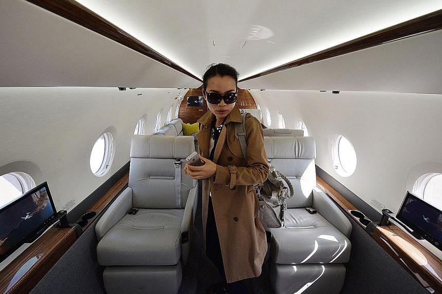 A Chinese woman in a private luxury business jet at Shanghai's Hongqiao airport. China's rapid economic growth has produced a wealthy elite whose members can afford to send their children to the US and even pay full college tuition.