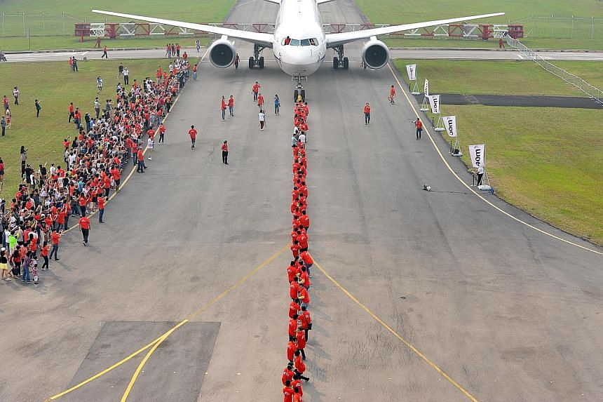 An 80-strong team including ST Aerospace's management, employees and clients pulled a 90,000kg Boeing 767-381ER passenger plane over 40m and into the Singapore Book Of Records yesterday. The feat performed at the company's Paya Lebar headquarters was