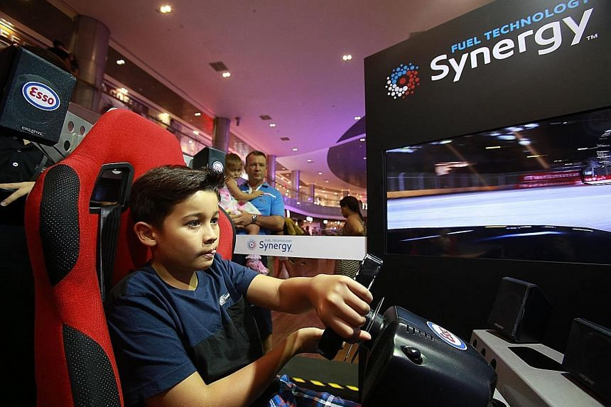 Singapore's junior go-kart racer Ryan Chapman, 11, tried his hand at a race-car simulator at the Esso Synergy Race Off event at ION Orchard yesterday, and clocked one of the day's fastest times. The event celebrates Esso's recent launch of its Synerg