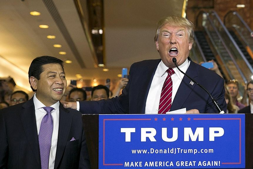 Mr Donald Trump introducing Indonesian Speaker of the House Setya Novanto, who made a surprise appearance at a campaign event.