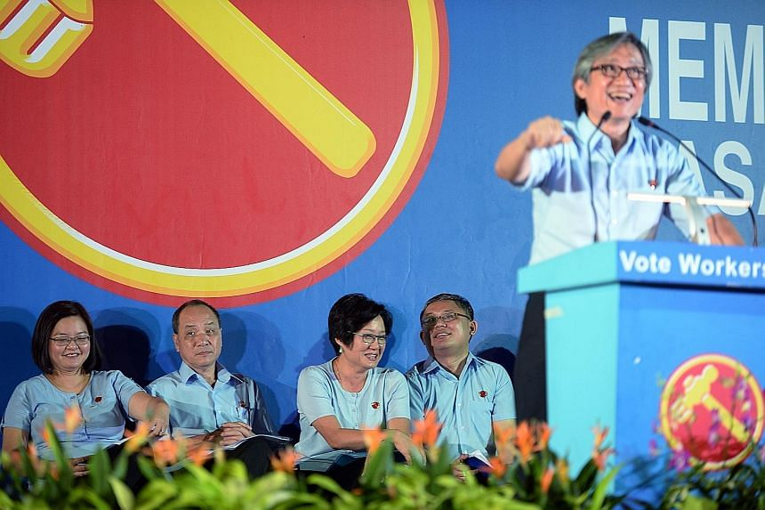 The Workers' Party's Mr Chen Show Mao speaking at the party's rally for Punggol East last night. With him were (from left) the WP's Punggol East SMC candidate Lee Li Lian, party chief Low Thia Khiang, chairman Sylvia Lim and Mr Koh Choong Yong, who i