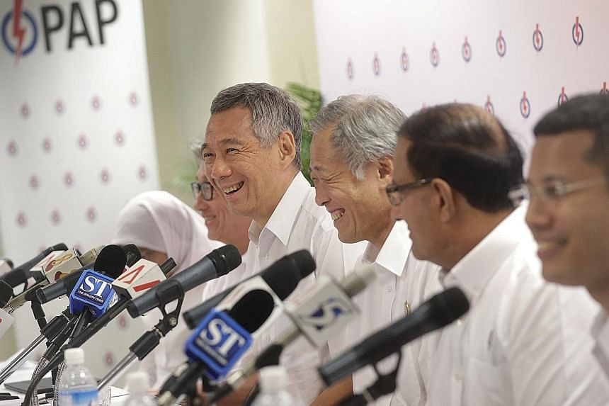 (From far left) Madam Halimah Yacob, Mr Lim Swee Say, Prime Minister Lee Hsien Loong, Dr Ng Eng Hen, Mr S. Iswaran and Mr Desmond Lee at a press conference at the PAP's headquarters yesterday. Senior PAP leaders, such as Dr Ng, put potential candidat