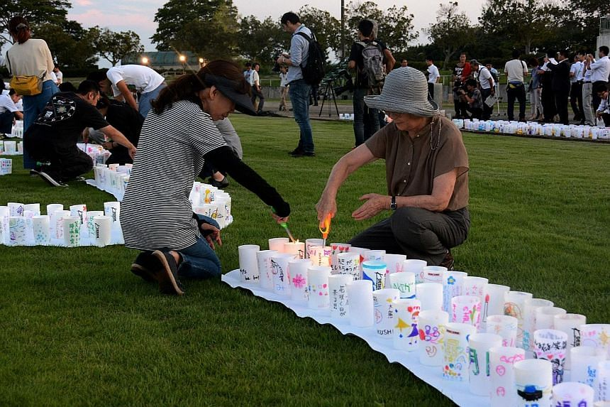 Residents holding a candlelight vigil in Naraha on Friday to mark the rebirth of their town, which was evacuated after the nuclear crisis more than four years ago. The authorities say that the town, one of several affected by the March 2011 disaster,