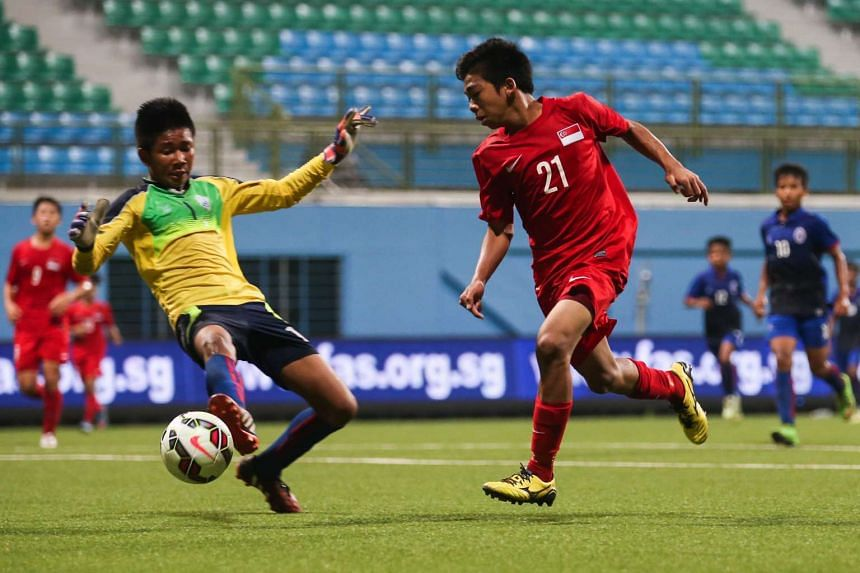 Singapore's U-15 team (in red) defeated Cambodia 3-1 during the Asian Football Confederation's Under-16 Championship qualifiers on Sept 6, 2015.