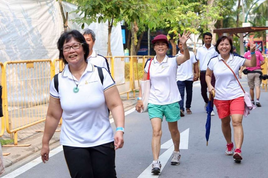 Participants posing for a photo during the 3km charitywalkathon.