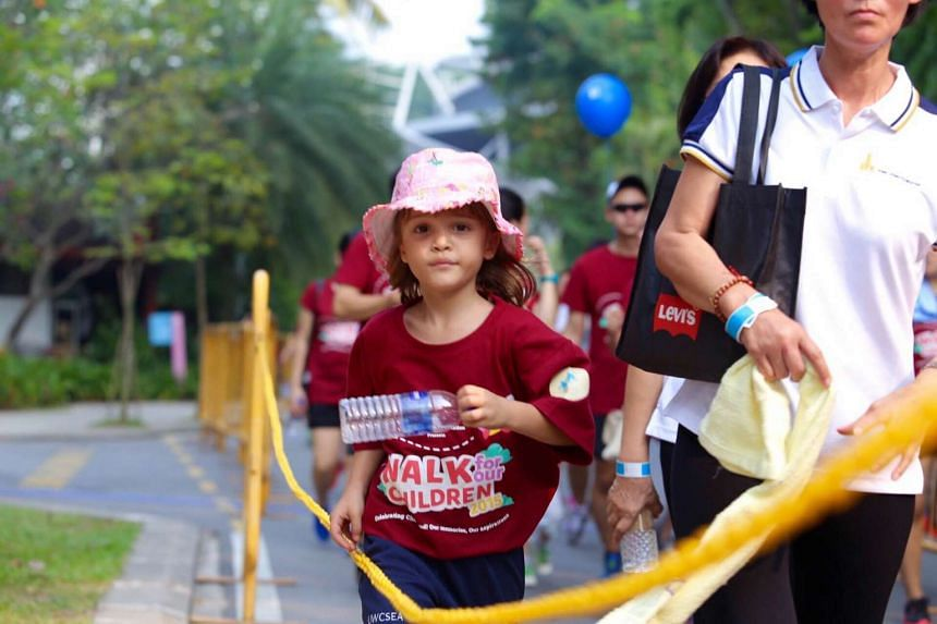 A child taking part in the Singapore Children's Society walkathon at Palawan beach on Sunday, Sept 6, 2015.