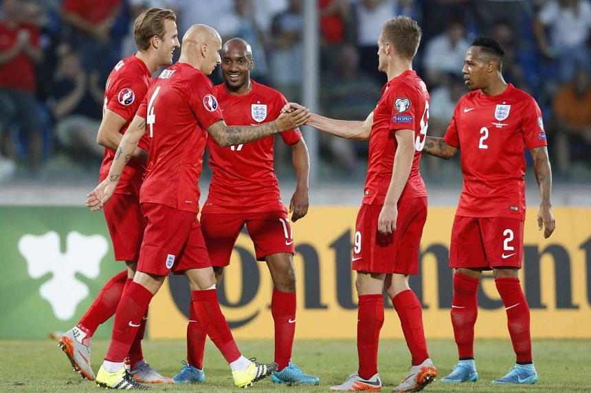 (From left) England's Harry Kane celebrates scoring their fifth goal with Jonjo Shelvey, Fabian Delph, Jamie Vardy and Nathaniel Clyne.