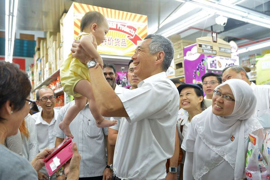 Prime Minister Lee Hsien Loong with Dr Intan Azura Mokhtar (right) during a visit to Sheng Siong supermarket in Serangoon North Avenue 4 last Thursday. Both candidates are part of the People's Action Party team that is contesting in Ang Mo Kio GRC.
