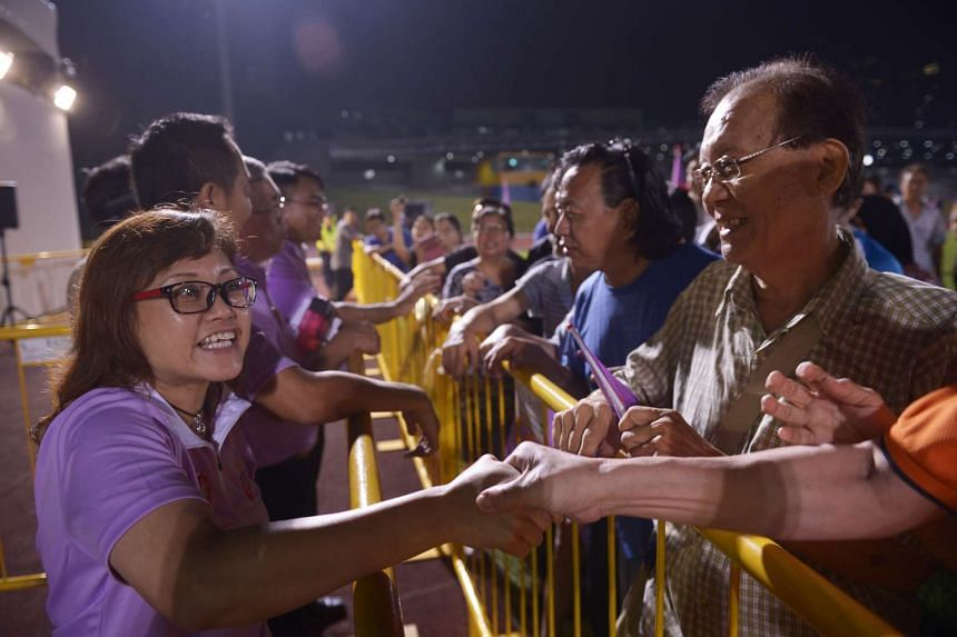 People's Power Party candidate for Chua Chu Kang GRC, Ms Low Wai Choo, greeting supporters at Bukit Gombak Stadium.
